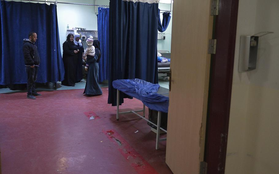 A group of family members gather in a ward for women and children at the West Irbil Emergency Hospital in Iraq, March 11, 2017. Months earlier, this ward was packed with patients on gurneys, many from the fighting in Mosul about 50 miles away, but new facilities are relieving some of the strain on the U.S.-built medical center.