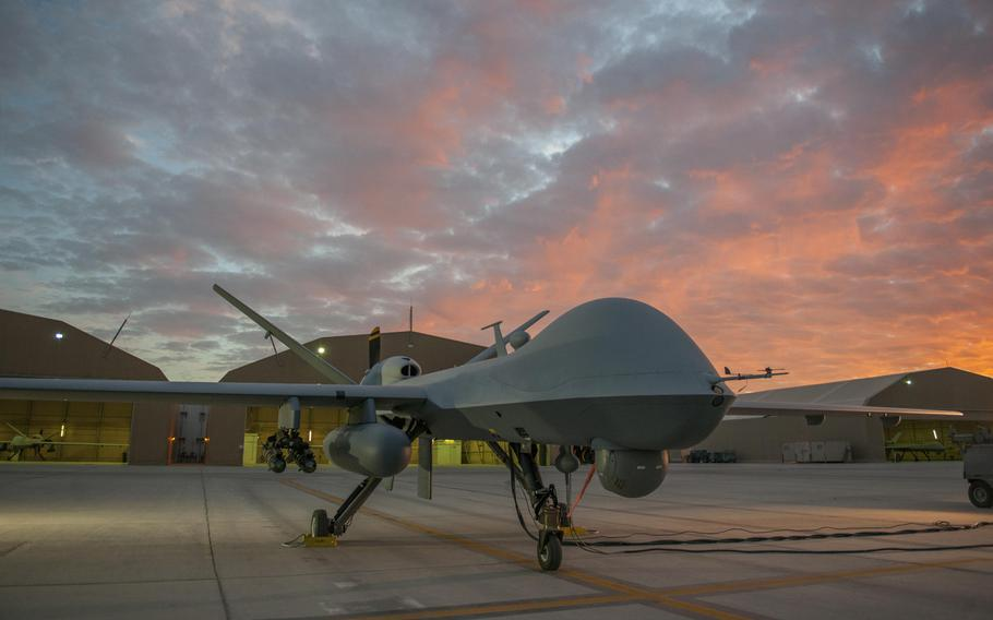 An MQ-9 Reaper equipped with an extended range modification from the 62nd Expeditionary Reconnaissance Squadron sits on the ramp at Kandahar Airfield, Afghanistan, Dec. 6, 2015.