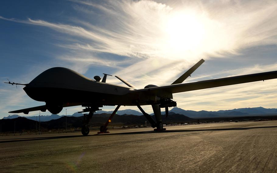 An MQ-9 Reaper sits on the flight line at Creech Air Force Base, Nev. The Reaper is an evolution of the MQ-1 Predator and can carry four AGM-114 Hellfire missiles and two 500 pound bombs while being able to fly for 18-24 hour missions.