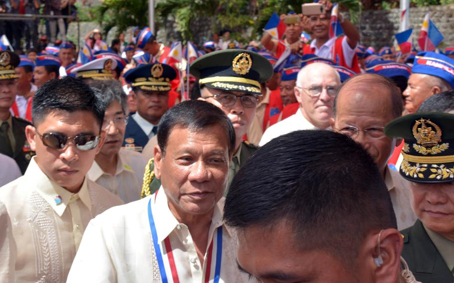 Philippines President Rodrigo Dutere, center, attends a ceremony marking the 75th anniversary of the Bataan surrender in Bataan, Philippines, Sunday, April 9, 2017.
