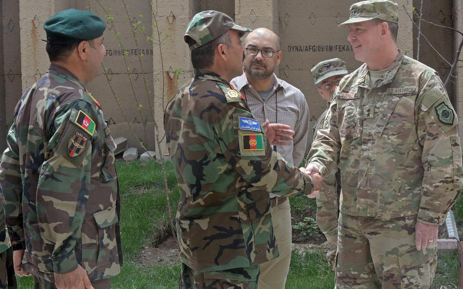 Incoming commander of 9th Air and Space Expeditionary Task Force-Afghanistan and NATO Air Command-Afghanistan Maj. Gen. James B. Hecker meets Afghan air force officials in Kabul shortly after assuming command on Tuesday, April 11, 2017.