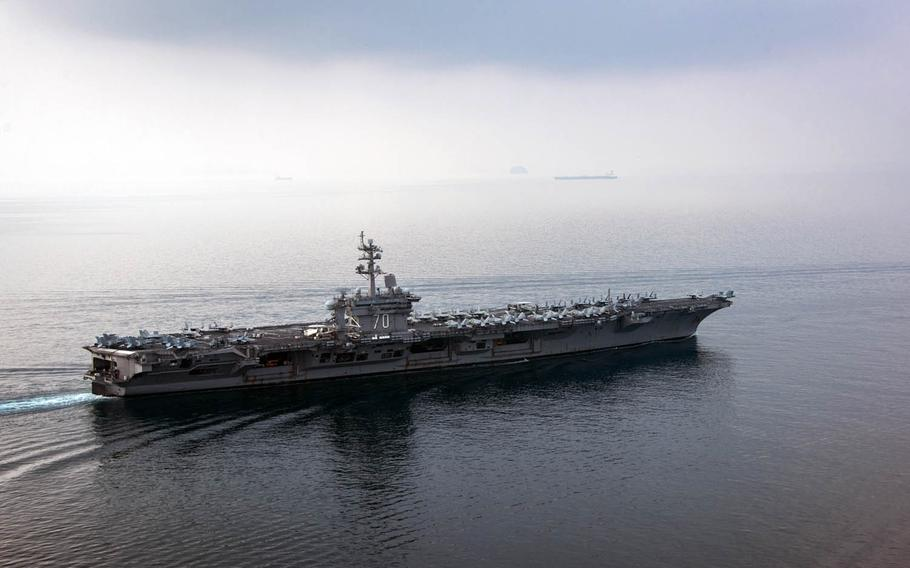 The aircraft carrier USS Carl Vinson transits the Sunda Strait off Indonesia, Saturday, April 15, 2017.