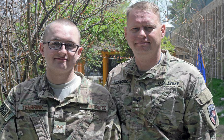 Air Force Senior Airman Benjamin D. TenBrink, left, and his father, Army Chief Warrant Officer Carl B. TenBrink, attend a barbeque at NATO's Resolute Support headquarters in Kabul, Afghanistan, on Tuesday, April 11, 2017, one of a few meetings between the two this year.