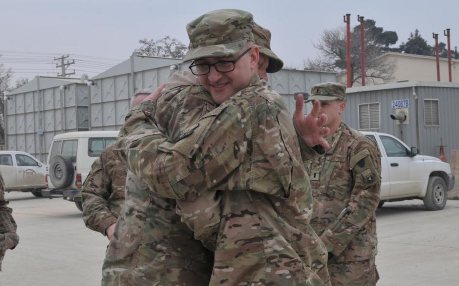 Air Force Senior Airman Benjamin D. TenBrink embraces his father, Army Chief Warrant Officer Carl B. TenBrink, at Bagram Air Field, Afghanistan, on Feb. 14, 2017. It's the first time the two have seen each other in two years.