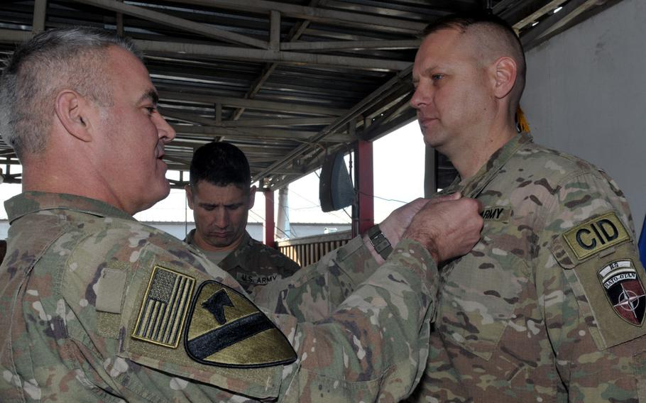 Maj. Gen. Richard Kaiser, commander of Combined Security Transition Command-Afghanistan, presents the Bronze Medal to Army Chief Warrant Officer Carl B. TenBrink on April 10, 2017.