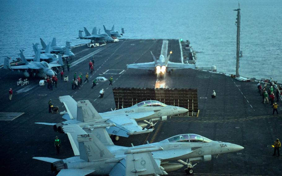 An F/A-18E Super Hornet from Strike Fighter Squadron 137 takes off from the aircraft carrier USS Carl Vinson in the South China Sea, April 12, 2017.