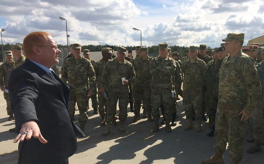 Robin Dothager, left, gives a tour of construction sites at Drawsko Pomorskie Training Area in Poland to USAREUR commander Lt. Gen. Ben Hodges, right, and other U.S. and allied leaders Wednesday, April 26, 2017. Poland has emerged as a new center of gravity for USAREUR, and dozens of facilities at several sites around the country are currently being built for storage, training and life support.
