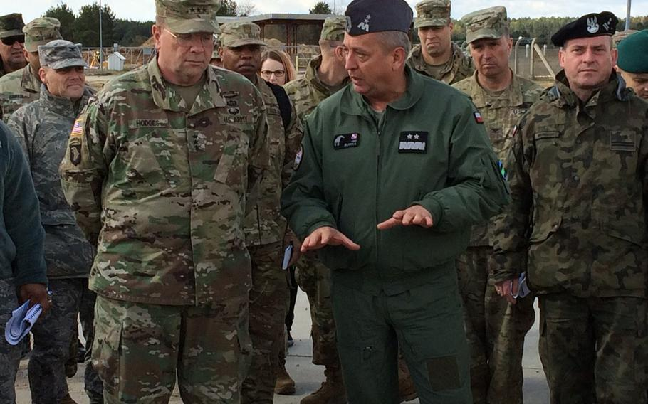 Lt. Gen. Ben Hodges, left, commander of U.S. Army Europe, confers with Polish Maj. Gen. Jan Sliwka during a visit to Drawsko Pomorskie Training Area, Poland, part of a four-day ''terrain walk'' of U.S. and allied leaders around strategic sites in central and Eastern Europe.