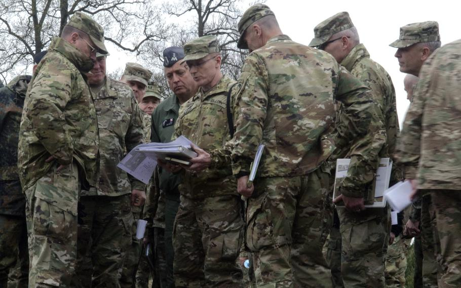 Col. John Baker, center, chief engineer for U.S. Army Europe, goes over plans for railhead expansion with Lt. Gen. Ben Hodges, left, USAREUR commander, and other U.S. and Polish leaders in Powidz, Poland, Wednesday, April 26, 2017.