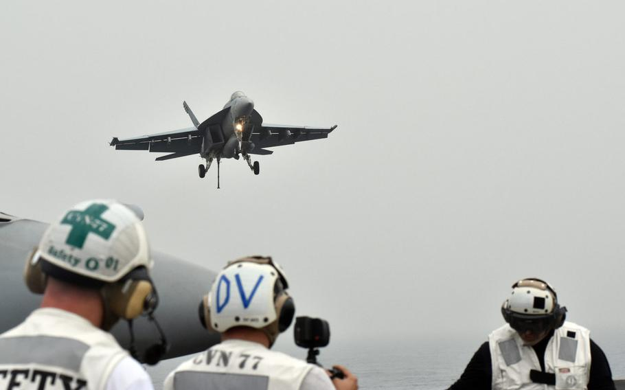 An F/A-18 Super Hornet approaches the USS George H.W. Bush on April 19, 2017. The Bush was launching sorties against the Islamic State group from the Persian Gulf.