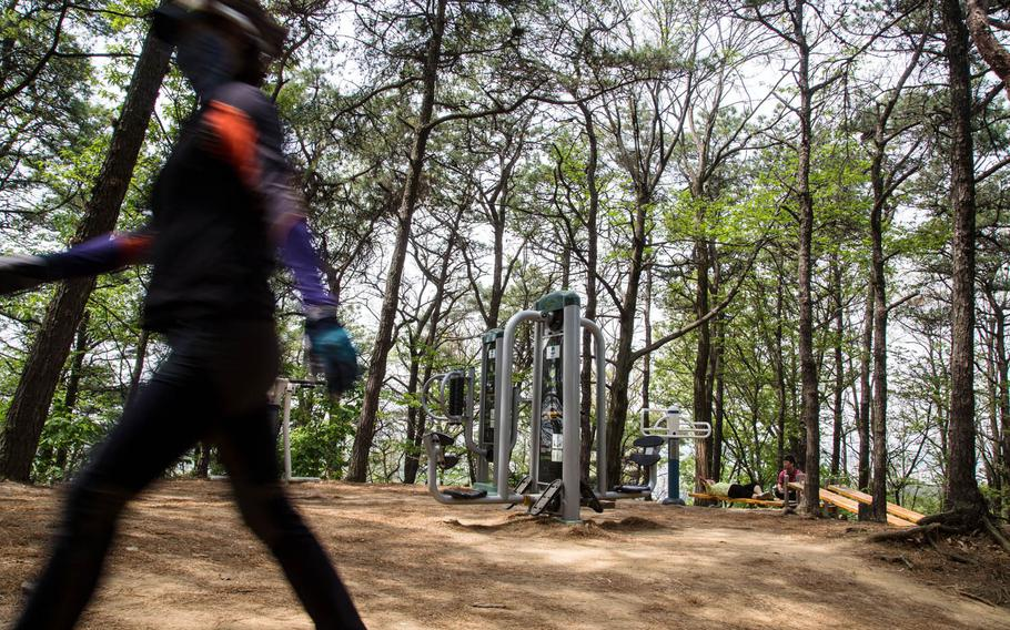 South Koreans hike, exercise and relax just minutes outside of Osan Air Base, South Korea, a presumed ground zero for rocket attacks in case of a war with the North, Tuesday, May 2, 2017.