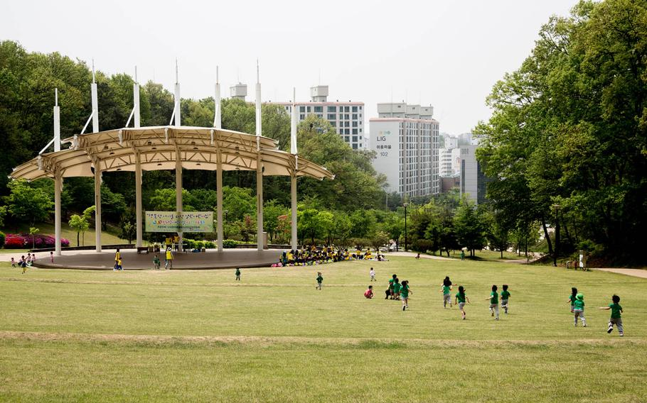 South Korean children enjoy a field trip to the park minutes outside of Osan Air Base, South Korea, a presumed ground zero for rocket attacks in case of a war with the North, Tuesday, May 2, 2017.