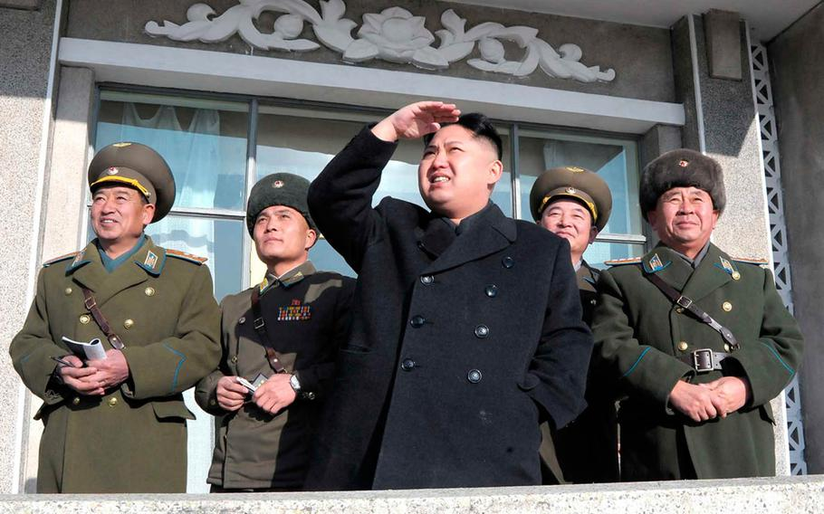 North Korean leader Kim Jong Un, center, is pictured in this undated image from the Korean Central News Agency.