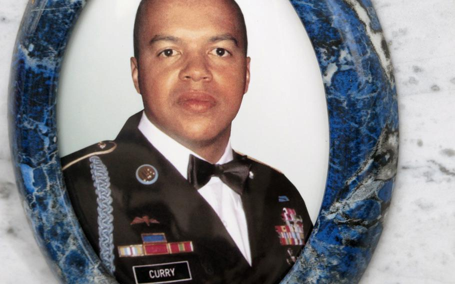 First Sgt. Michael Curry was killed in Afghanistan and was buried in Italy, where he'd made his home and life. His photograph appears on his cemetery site in Grantorto, Italy. The dining facility on Caserma Ederle is soon to be renamed the Curry Dining Facility