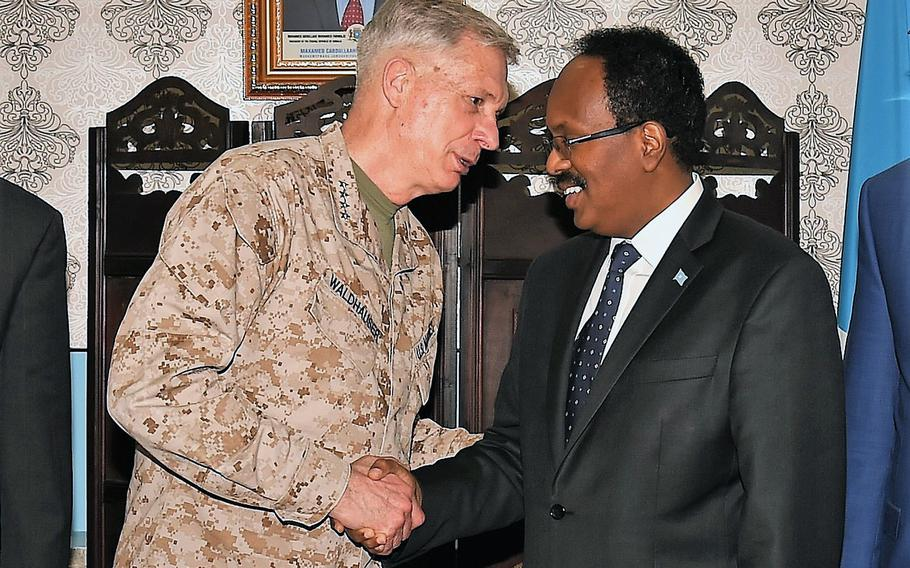 Commander of U.S. Africa Command, U.S. Marine Corps Gen. Thomas D. Waldhauser and President of Somalia Mohamed Abdullahi Mohamed, shake hands after their meeting held at Mogadishu International Airport, Somalia, Saturday, April 29, 2017.