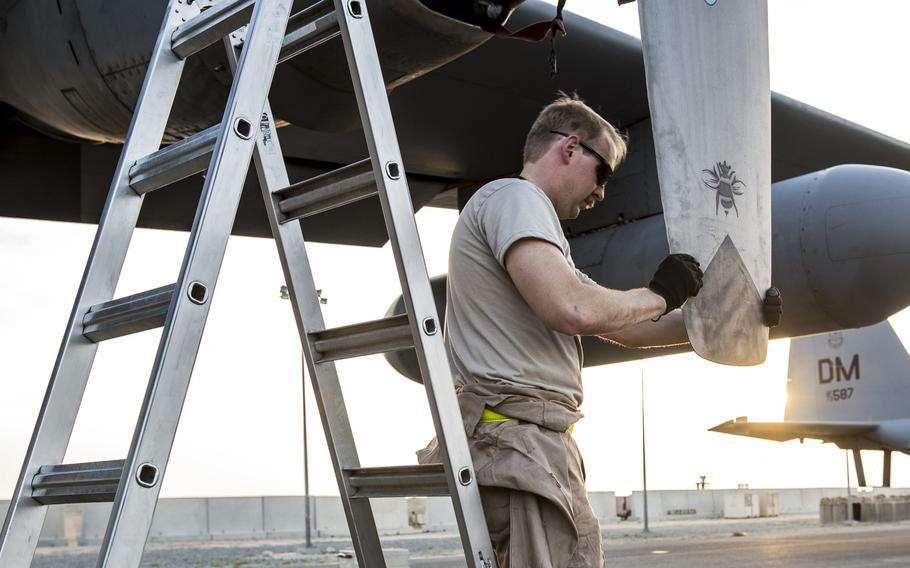 A crew member at an undisclosed location in Southwest Asia ensures the propellers of an EC-130H Compass Call are properly working, March 21, 2017.