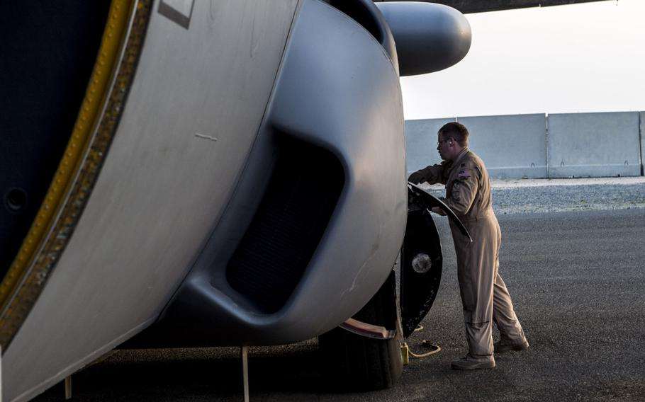 A flight crew member preflight checks an EC-130H Compass Call at an undisclosed location in Southwest Asia prior before a mission supporting the campaign against the Islamic State in Iraq and Syria, March 21, 2017.