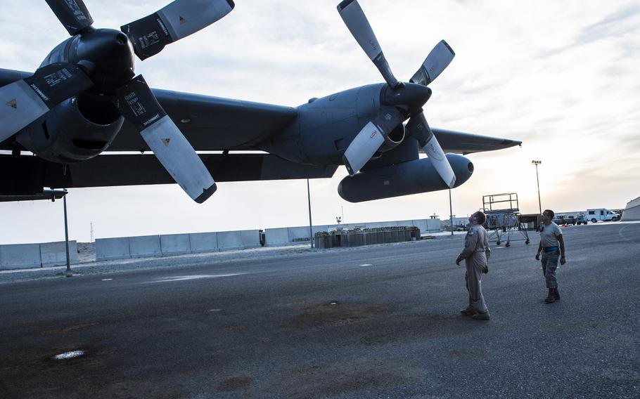 Crew members do a preflight check of the propellers on an EC-130H Compass Call at an undisclosed location in Southwest Asia before a mission supporting the campaign against the Islamic State in Iraq and Syria, March 21, 2017.