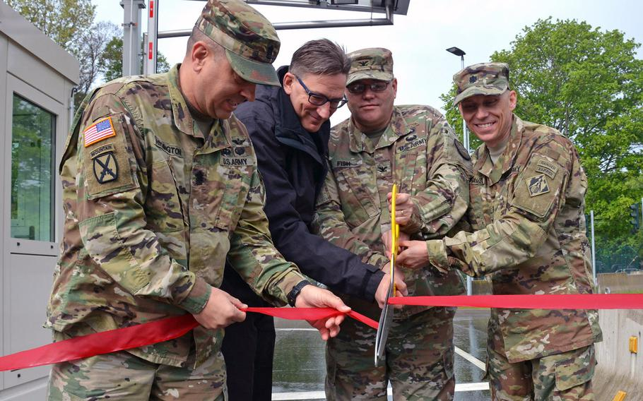 From left, Command Sgt. Maj. Larry Addington, U.S. Army Garrison Wiesbaden command sergeant major, Wolfgang Schnitzer, director of Landesbetrieb Bau und Immobilien Hessen, Col. Todd J. Fish, USAG Wiesbaden commander, and Lt. Col. John H. McNamara, deputy commander, Europe District, US Army Corps of Engineers, officially open the new access control point for USAG Wiesbaden's Hainerberg complex. The new ACP will replace the two current gates when it begins operations May 13.