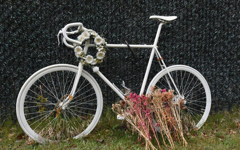 A bicycle memorial sits by the roadside outside Ramstein Air Base, Germany, near where Air Force Staff Sgt. Grant Davis died on March 26, 2016, when his bicycle was struck by a car. Senior Airman Benjamin Hann was convicted Wednesday, May 3, 2017, of negligent homicide in connection with Davis's death.