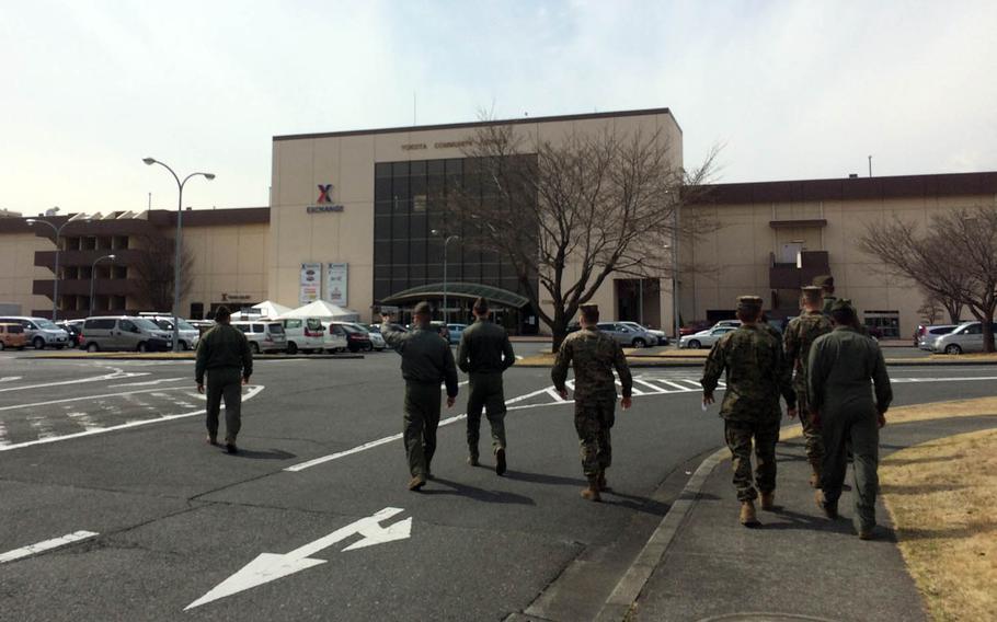 Marines walk toward the Yokota Community Center at Yokota Air Base, Japan, where renovations are adding 25,000 square feet of space to the Base Exchange.