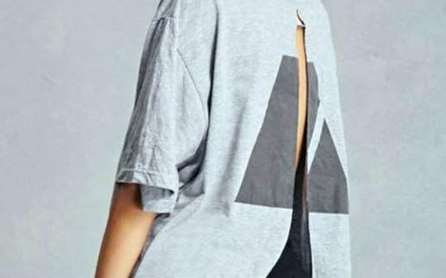 """Forever 21's """"Repurposed Army graphic tee"""" featured a wide slit cut in the back of a replica Army PT shirt."""