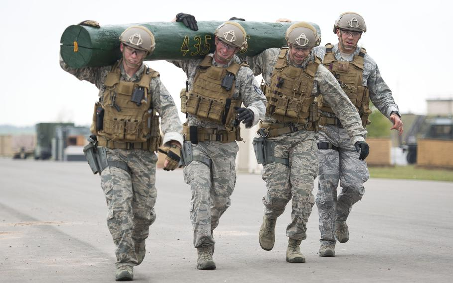 A 435th Security Forces Squadron team carries a log during the inaugural 435th Contingency Response Group Olympics at Ramstein Air Base, Germany, on Friday, May 5, 2017.
