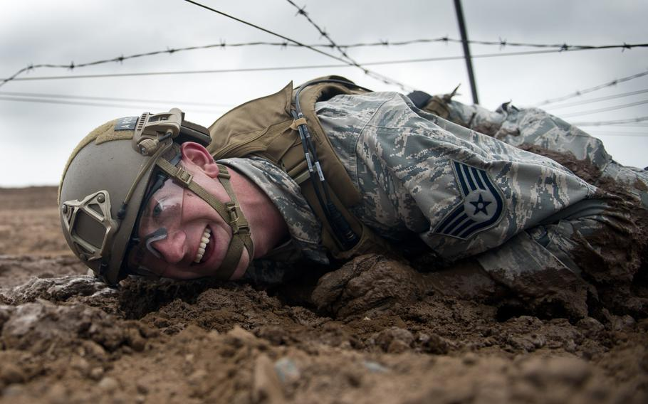 Staff Sgt. Jacob Van Dyke, from the 435th Security Forces Squadron, crawls through the mud during the 435th Contingency Response Group Olympics at Ramstein Air Base, Germany, on Friday, May 5, 2017.
