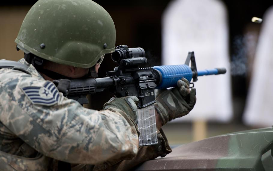 Tech. Sgt. Daniel Brown, from the 435th Construction and Training Squadron, fires at a target during the 435th Contingency Response Group Olympics at Ramstein Air Base, Germany, on Friday, May 5, 2017.