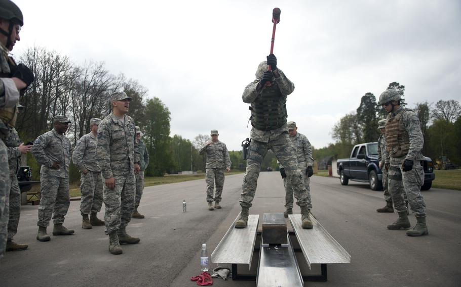 Master Sgt. David Thomas, from the 435th Construction and Training Squadron, hits a block of metal with a sledgehammer during the inaugural 435th Contingency Response Group Olympics at Ramstein Air Base, Germany, on Friday, May 5, 2017.