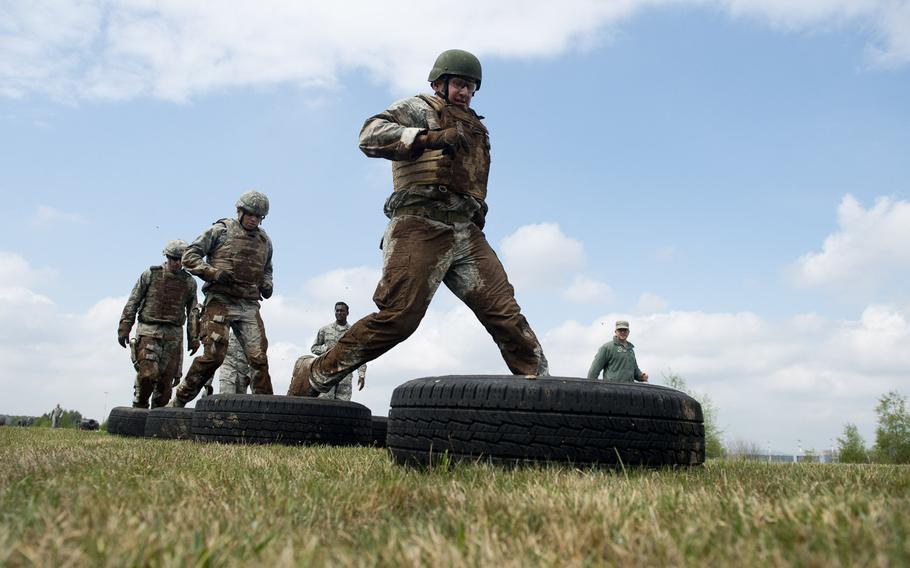 Master Sgt. Robert Fitte, from the 435th Construction and Training Squadron, runs through a tire obstacle during the 435th Contingency Response Group Olympics at Ramstein Air Base, Germany, on Friday, May 5, 2017.