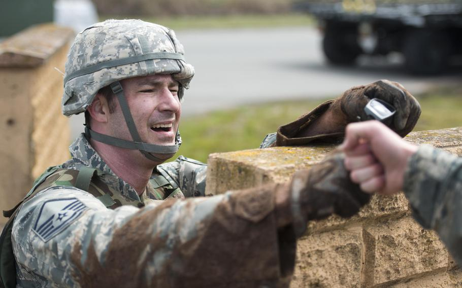 Master Sgt. David Thomas, from the 435th Construction and Training Squadron, takes a short break during the 435th Contingency Response Group Olympics at Ramstein Air Base, Germany, on Friday, May 5, 2017.