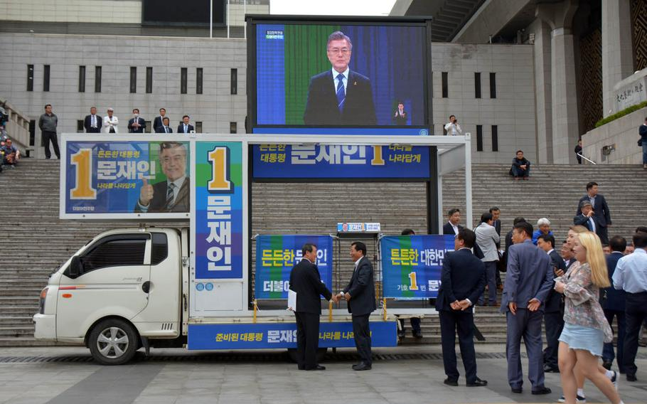 Supporters of South Korean presidential election front-runner Moon Jae-in prepare for a rally on a central square in Seoul, Monday, May 8, 2017.