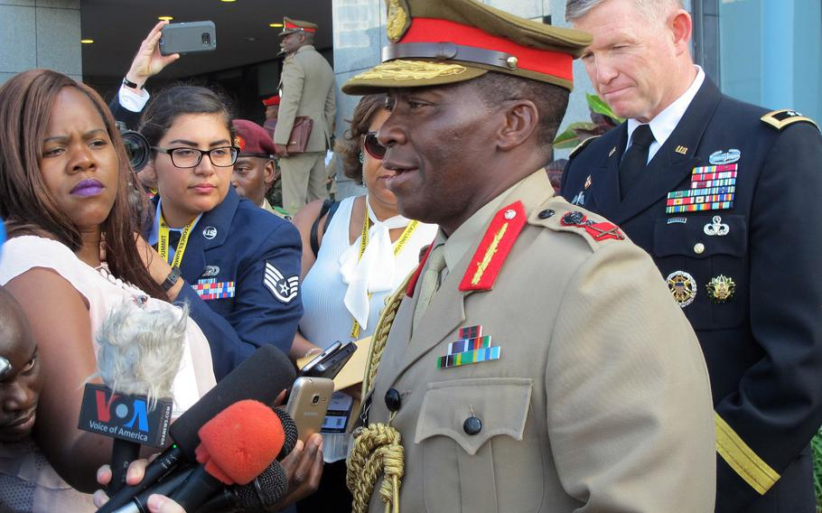 Gen. Griffin Spoon Phiri, commander of the Malawi Defense Forces, and Maj. Gen. Joseph Harrington, commander of U.S. Army Africa, speak to journalists on the first day of the African Land Forces Summit in Lilongwe, Malawi, on Monday May 8, 2017. The summit hosted by U.S. Army Africa seeks to develop cooperation and closer military ties on the African continent.