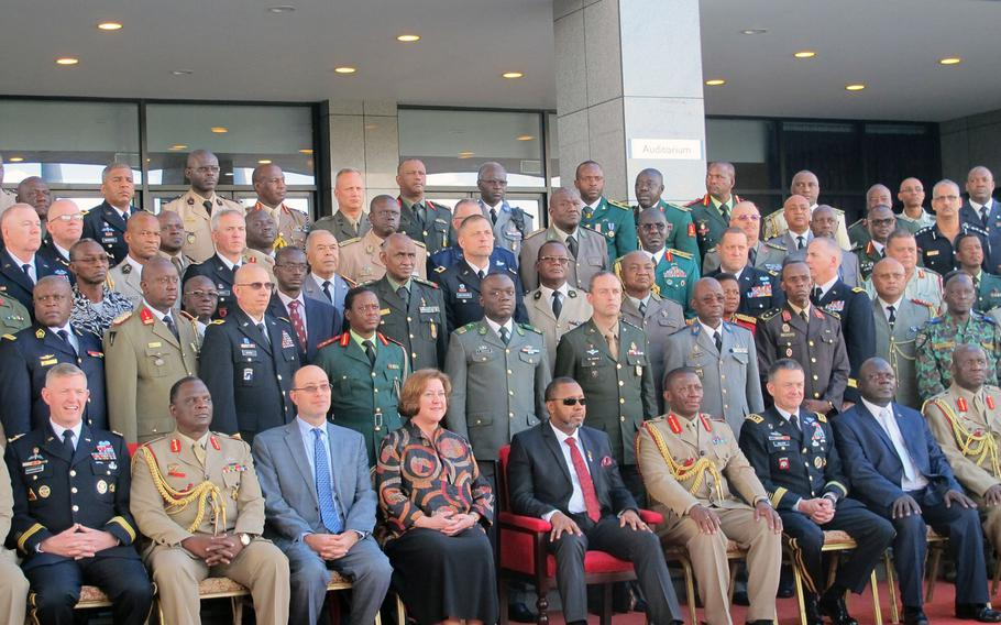 African army chiefs, U.S. generals, the U.S. ambassador to the African Union and the vice-president of Malawi, all on hand for the first day on Monday, May 8, 2017,  of the African Land Forces Summit, pose for a photo. The summit hosted by U.S. Army Africa seeks to develop trust, cooperation and friendly military relationships on the African continent.