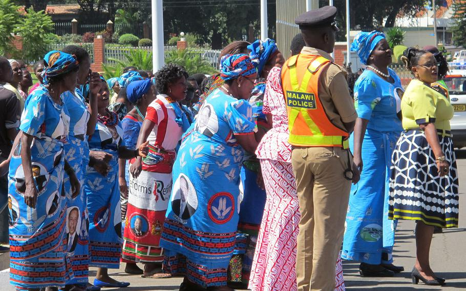Dancers and singers lined the street as Malawi Vice President Saulos Klaus Chilima departed in his motorcade from the African Land Forces Summit in Lilongwe, Malawi, on  Monday. May 8, 2017.