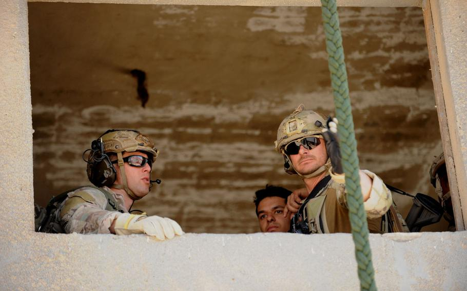 Airmen assigned to personnel recovery troop 2350, prepare to exit a 2nd story window during Exercise Eager Lion in Amman, Jordan, on Monday,  May 7, 2017.
