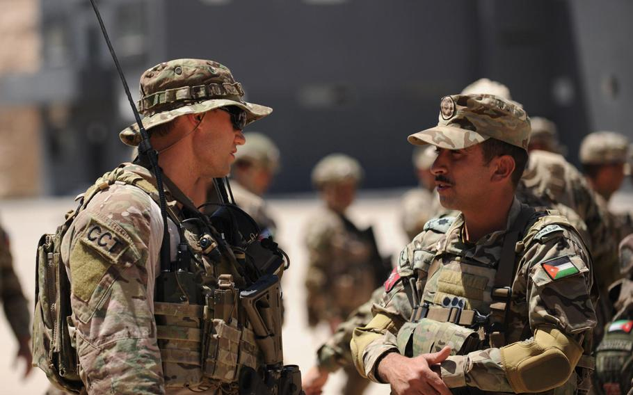 An Air Force Special Tactics Officer discusses safety procedures with a Jordanian officer at the King Abdullah II Special Operations Training Center  during Exercise Eager Lion in Amman, Jordan, on Monday, May 7, 2017.