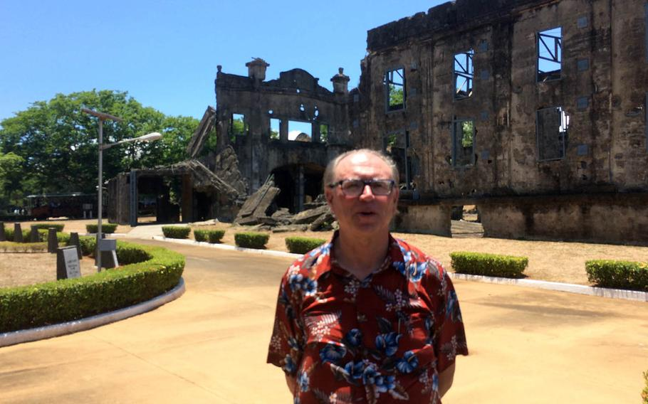 Steve Kwiecinski, 65, of Virginia, Minn., whose Army staff sergeant father was captured by the Japanese on Corregidor during World War II, stands in front of the ruins of an old theater on the Philippine island, Saturday, May 6, 2017.