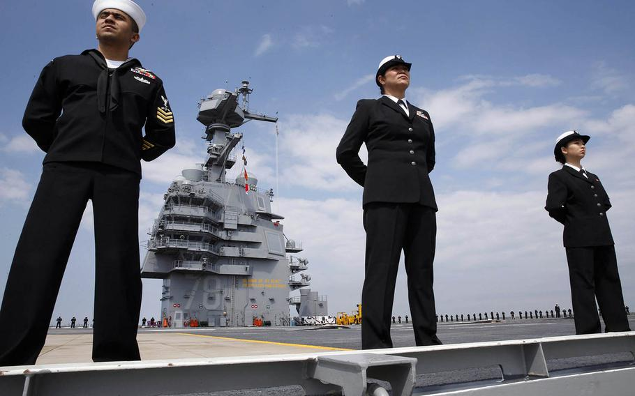 Sailors man the rails of the USS Gerald R. Ford as the aircraft carrier returns to Norfolk, Va., after conducting builder's sea trials, April 14, 2017.