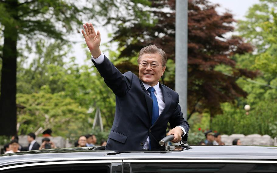 New South Korean President Moon Jae-in waves to supporters in Seoul, Wednesday, May 10, 2017.