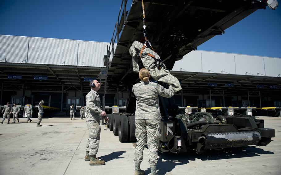 Senior Airmen Christopher Pieczynski, left, and Sarah Isbell assist a simulated fall victim during fall protection training at Ramstein Air Base, Germany, on Wednesday, May 10, 2017. Pieczynski and Isbell are both from the 721st Aerial Port Squadron.