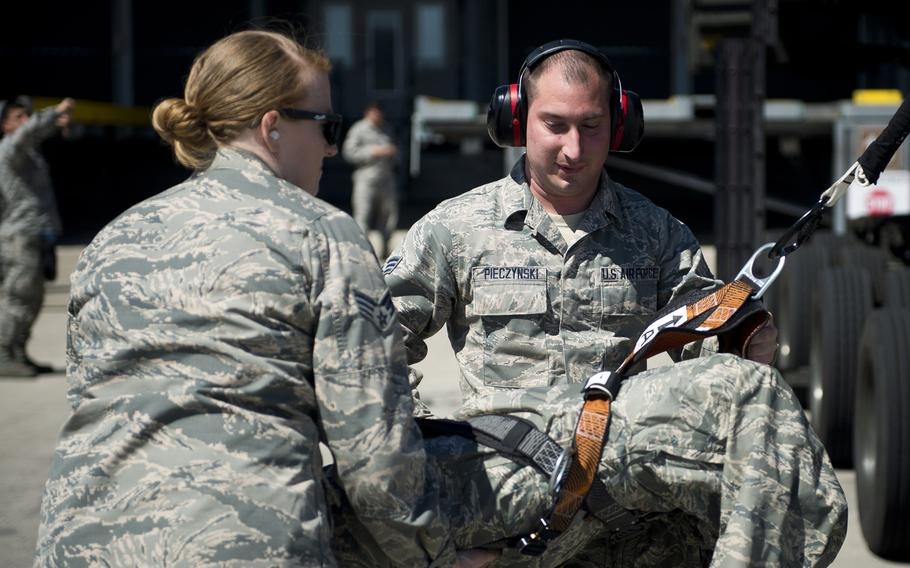 Senior Airmen Christopher Pieczynski, right, and Sarah Isbell assist a simulated fall victim during fall protection training at Ramstein Air Base, Germany, on Wednesday, May 10, 2017.