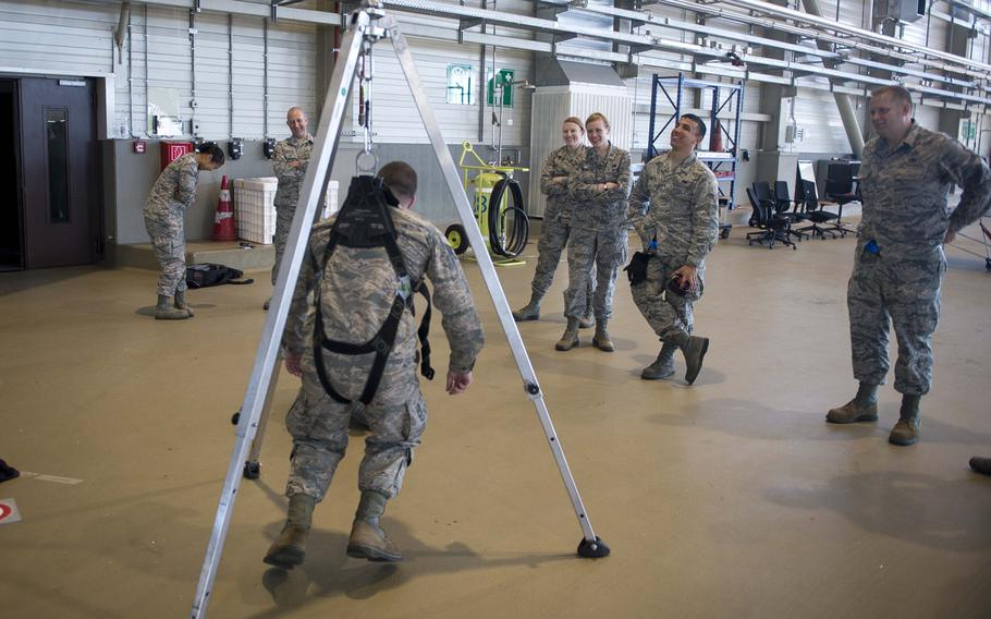 Senior Airman Christopher Pieczynski hangs in a harness during fall protection training at Ramstein Air Base, Germany, on Wednesday, May 10, 2017.