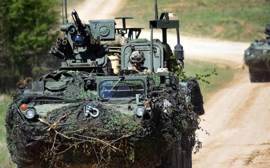 American soldiers speed toward their objective in a Stryker during Exercise Saber Junction in Hohenfels, Germany, Wednesday, May 10, 2017.
