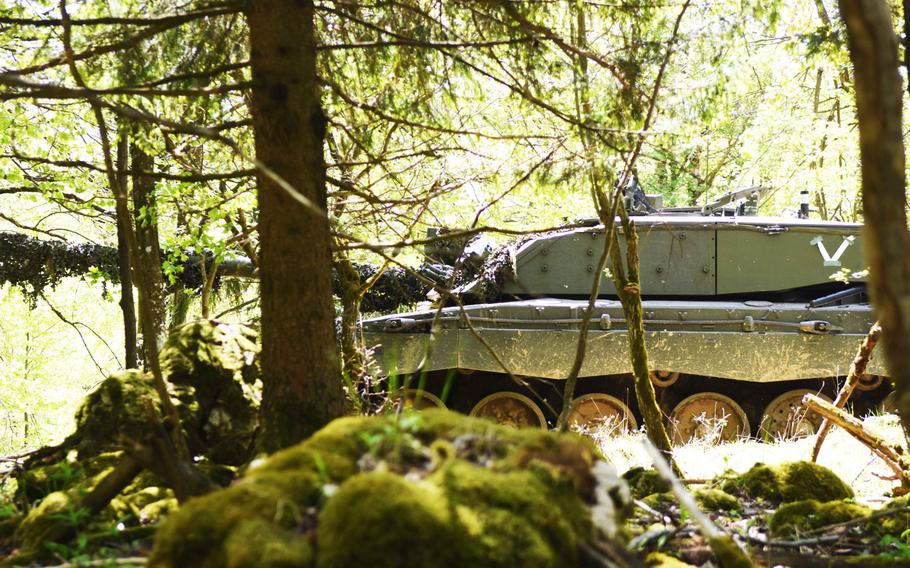 A British Challenger II tank moves through in the forest in Hohenfels, Germany, during Exercise Saber Junction, Wednesday, May 10, 2017.