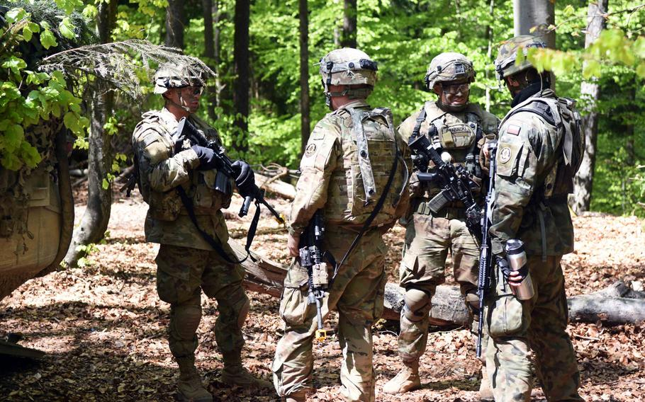 American, Polish and British soldiers train in Hohenfels, Germany, during Exercise Saber Junction, Wednesday, May 10, 2017.