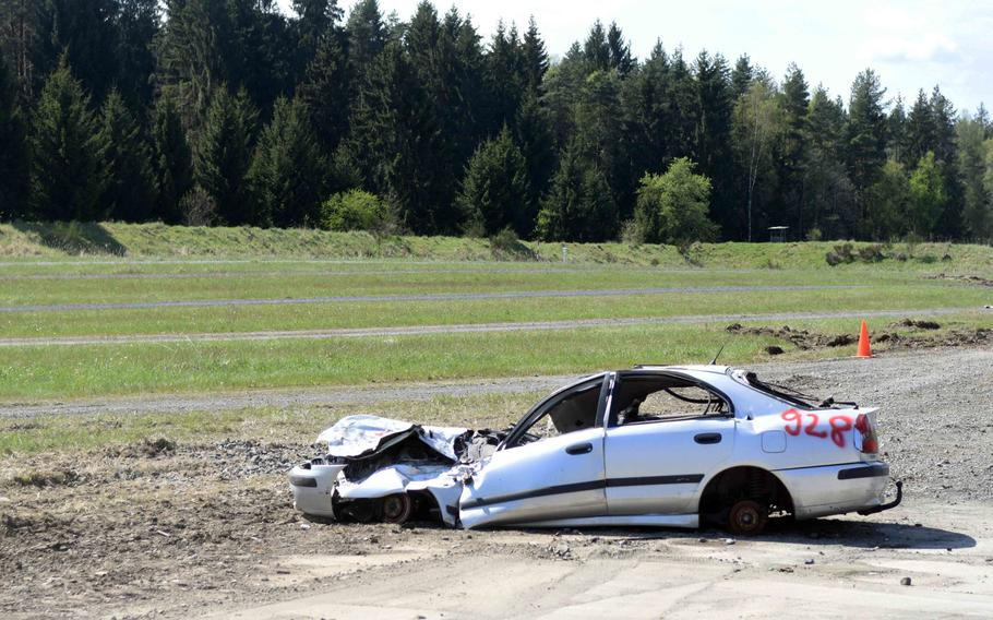 The aftermath of a Ukrainian T-64BM tank driving through the front end of this car, set up as an obstacle at the Strong Europe Tank Challenge at Grafenwoehr, Germany, Thursday, May 11, 2017.