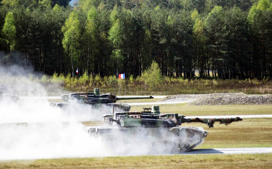 French Leclerc tanks speed to their targets at the Strong Europe Tank Challenge at Grafenwoehr, Germany, Thursday, May 11, 2017.