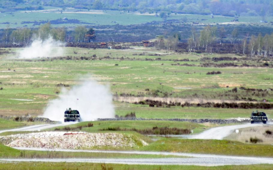 French tankers firing on targets in Leclerc tanks during the Strong Europe Tank Challenge at Grafenwoehr, Germany, Thursday, May 11.